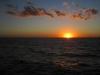 Západ slunce za hraniční řeku Uruguay